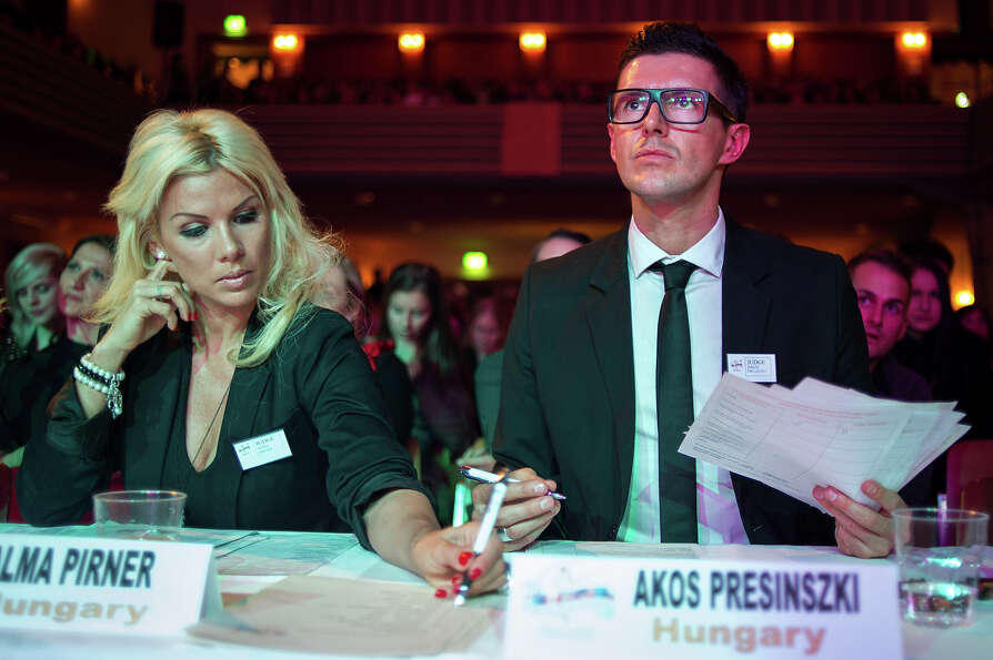 Judges mark a competitor participating at the World Pole Dancing Championship 2012 held at the Volks
