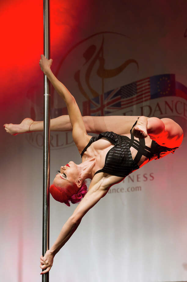 A competitor participates at the World Pole Dancing Championship 2012 held at the Volkshaus on November 10, 2012 in Zurich, Switzerland. The public's perception of pole dancing has recently changed to become a popular sport combining physical strength, technique and choreography. Photo: Harold Cunningham, Getty Images / 2012 Getty Images