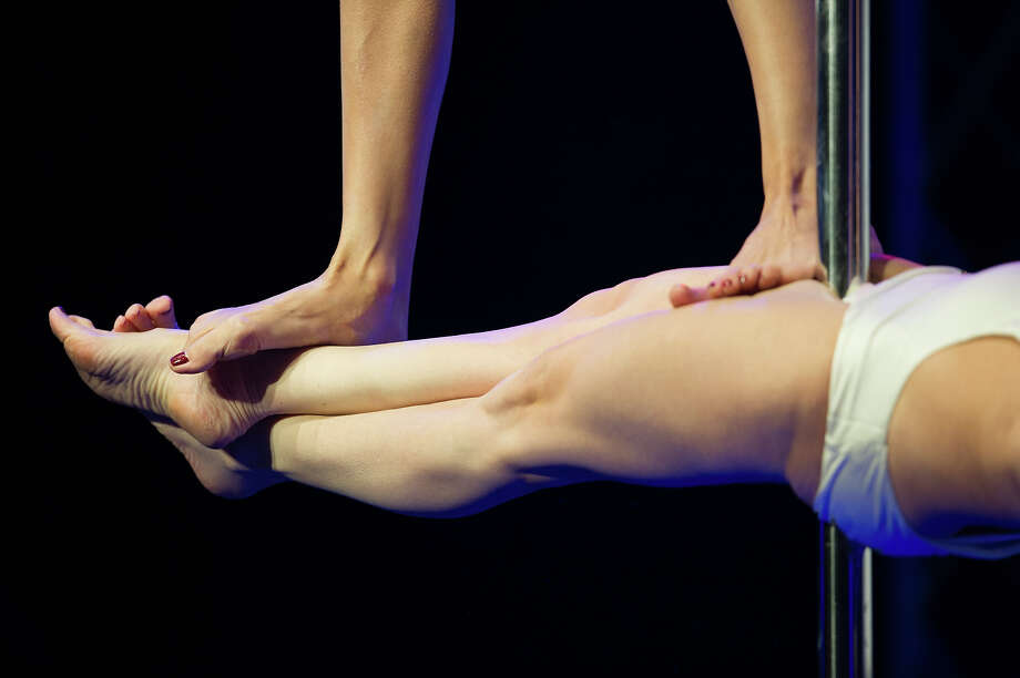ZURICH, SWITZERLAND - NOVEMBER 10:  Details of competitors as she participates at the World Pole Dancing Championship 2012 held at the Volkshaus on November 10, 2012 in Zurich, Switzerland. The public's perception of pole dancing has recently changed to become a popular sport combining physical strength, technique and choreography. Photo: Harold Cunningham, Getty Images / 2012 Getty Images