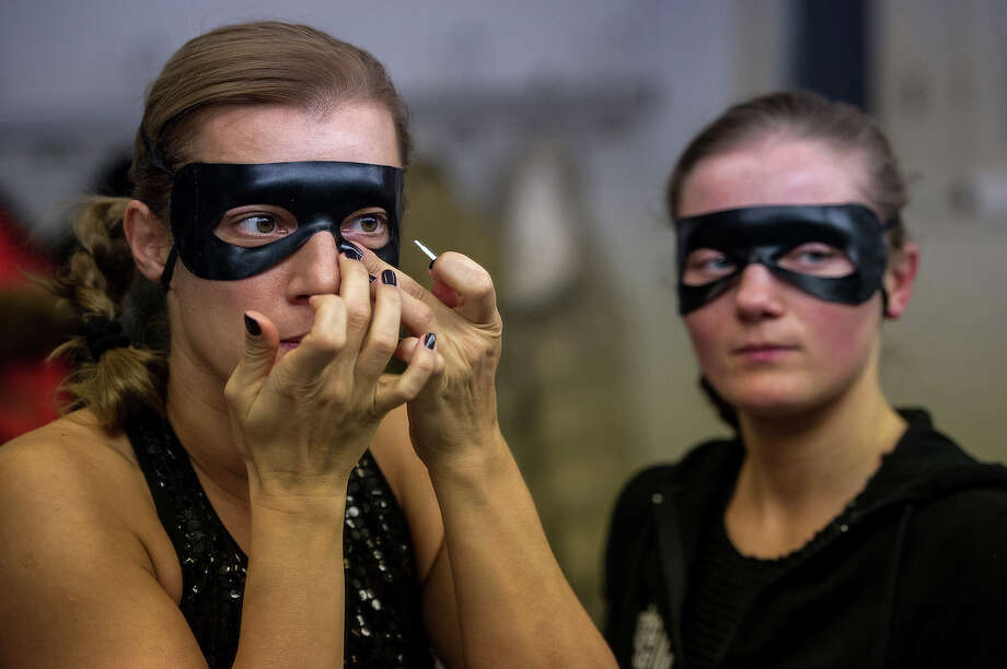 ZURICH, SWITZERLAND - NOVEMBER 10:  Competitors prepare prior to participating at the World Pole Dancing Championship 2012 held at the Volkshaus on November 10, 2012 in Zurich, Switzerland. The public's perception of pole dancing has recently changed to become a popular sport combining physical strength, technique and choreography. Photo: Harold Cunningham, Getty Images / 2012 Getty Images