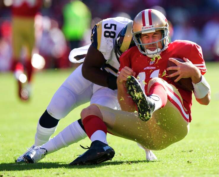 San Francisco 49ers quarterback Alex Smith (11) is tackled by St. Louis Rams linebacker Jo-Lonn Dunb