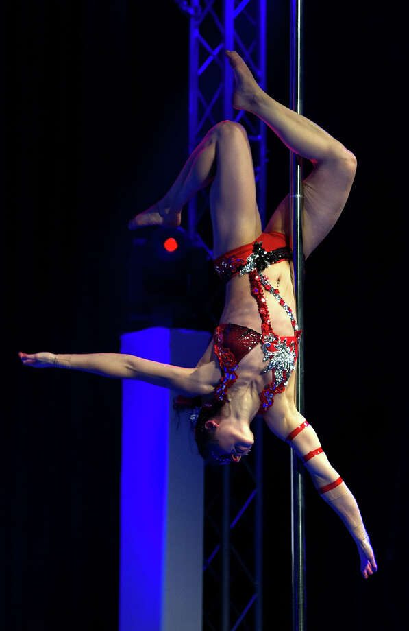 ZURICH, SWITZERLAND - NOVEMBER 10:  A competitor participates at the World Pole Dancing Championship 2012 held at the Volkshaus on November 10, 2012 in Zurich, Switzerland. The public's perception of pole dancing has recently changed to become a popular sport combining physical strength, technique and choreography. Photo: Harold Cunningham, Getty Images / 2012 Getty Images