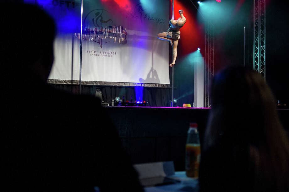 ZURICH, SWITZERLAND - NOVEMBER 10:  Judges watch a competitor participating at the World Pole Dancing Championship 2012 held at the Volkshaus on November 10, 2012 in Zurich, Switzerland. The public's perception of pole dancing has recently changed to become a popular sport combining physical strength, technique and choreography. Photo: Harold Cunningham, Getty Images / 2012 Getty Images
