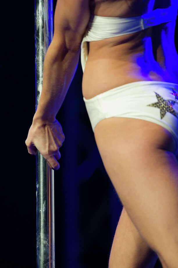 ZURICH, SWITZERLAND - NOVEMBER 10:  A detail of a competitor as she participates at the World Pole Dancing Championship 2012 held at the Volkshaus on November 10, 2012 in Zurich, Switzerland. The public's perception of pole dancing has recently changed to become a popular sport combining physical strength, technique and choreography. Photo: Harold Cunningham, Getty Images / 2012 Getty Images