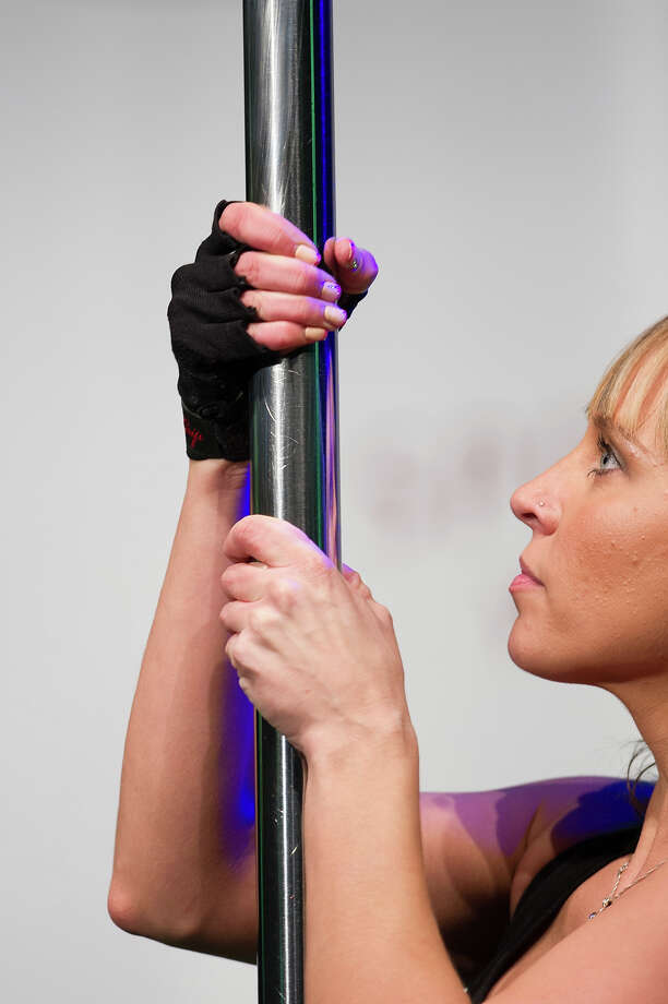 ZURICH, SWITZERLAND - NOVEMBER 10:  A pole cleaner looks on during the World Pole Dancing Championship 2012 held at the Volkshaus on November 10, 2012 in Zurich, Switzerland. The public's perception of pole dancing has recently changed to become a popular sport combining physical strength, technique and choreography. Photo: Harold Cunningham, Getty Images / 2012 Getty Images