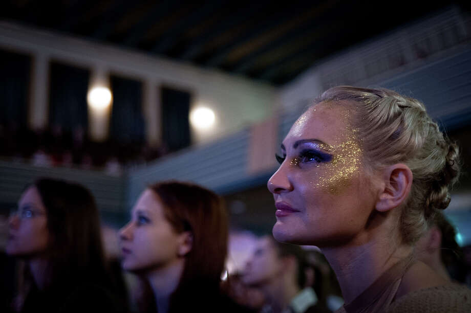 ZURICH, SWITZERLAND - NOVEMBER 10:  The audience looks at a competitor participating at the World Pole Dancing Championship 2012 held at the Volkshaus on November 10, 2012 in Zurich, Switzerland. The public's perception of pole dancing has recently changed to become a popular sport combining physical strength, technique and choreography. Photo: Harold Cunningham, Getty Images / 2012 Getty Images