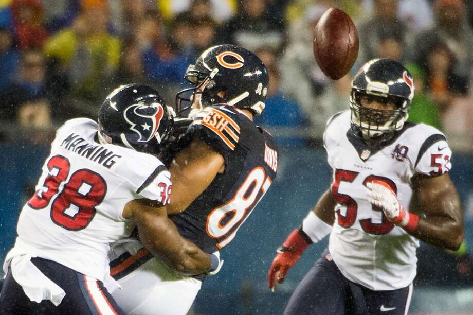 Bears tight end Kellen Davis (87) fumbles as he is hit by Texans free safety Danieal Manning (38) for a turnover during the first quarter. (Smiley N. Pool / Houston Chronicle)