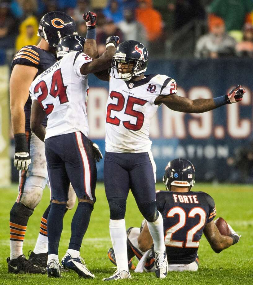 Texans cornerback Johnathan Joseph (24) and cornerback Kareem Jackson (25)] celebrate a stop on Chicago Bears running back Matt Forte (22) during the second quarter. (Smiley N. Pool / Houston Chronicle)