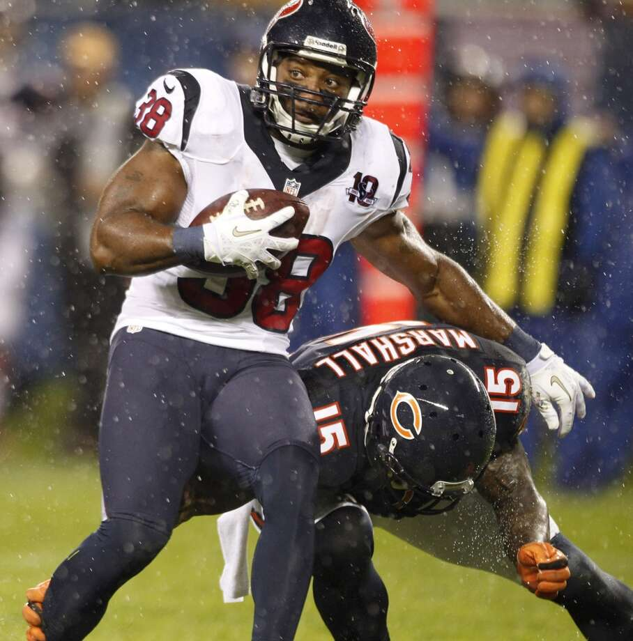 Texans free safety Danieal Manning (38) is brought down by Bears wide receiver Brandon Marshall (15) after intercepting a pass during the first half. (Brett Coomer / Houston Chronicle)