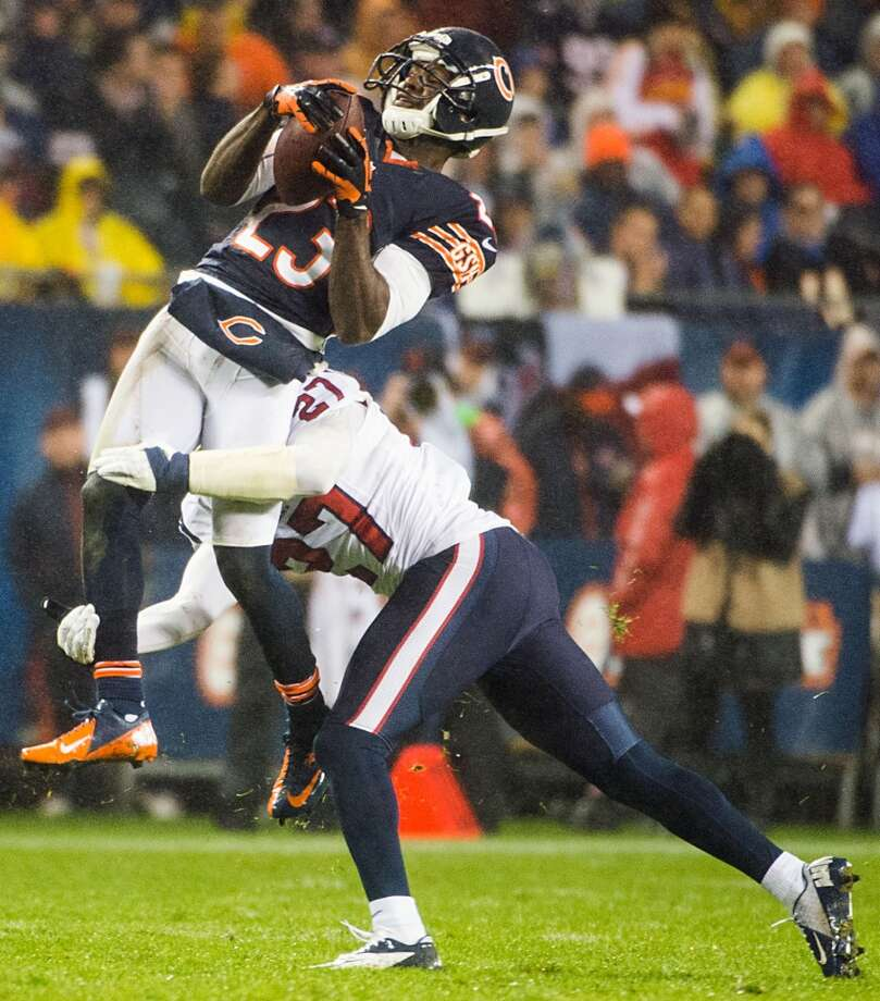 Chicago Bears wide receiver Devin Hester (23) makes a catch as he is hit by Houston Texans defensive back Quintin Demps (27) during the second quarter. (Smiley N. Pool / Houston Chronicle)