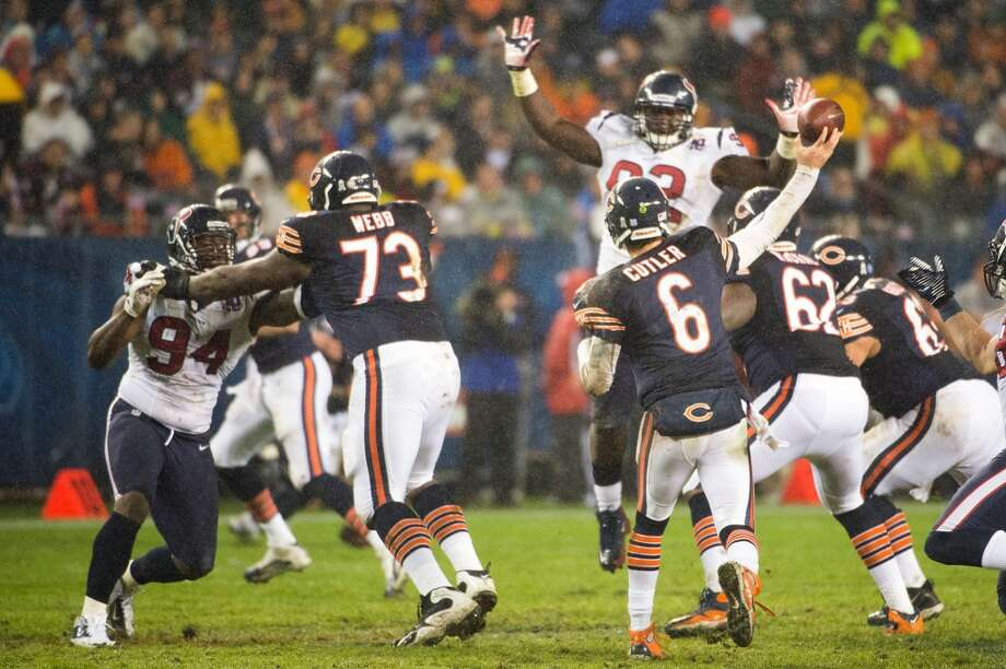 Bears quarterback Jay Cutler (6) throws over Houston Texans defensive tackle Earl Mitchell (92) only to be intercepted by cornerback Kareem Jackson during the second quarter. (Smiley N. Pool / Houston Chronicle)