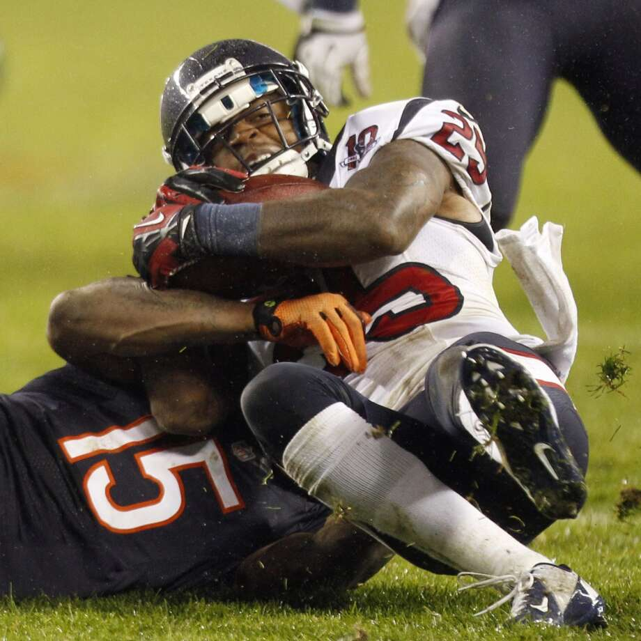 Texans cornerback Kareem Jackson (25) wrestles the ball away from Bears wide receiver Brandon Marshall (15) for an interception during the second quarter. (Brett Coomer / Houston Chronicle)