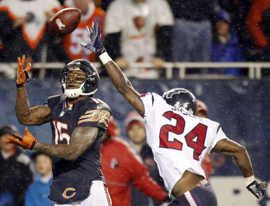 Bears wide receiver Brandon Marshall (15) can't haul in a touchdown pass as Houston Texans cornerback Johnathan Joseph (24) defends during the second quarter. (Brett Coomer / Houston Chronicle)