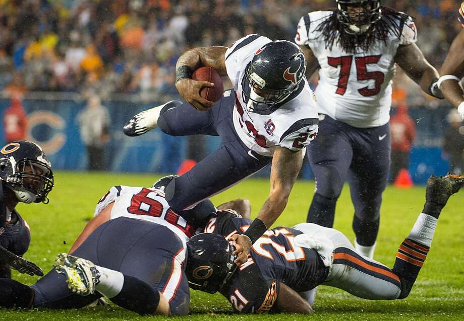 Texans running back Arian Foster (23) is upended by Chicago Bears strong safety Major Wright (21) during the first quarter. (Smiley N. Pool / Houston Chronicle)