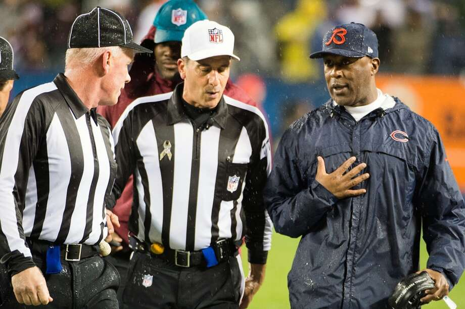Bears head coach Lovie Smith argues for a call from referee Gene Steratore during the second quarter. (Smiley N. Pool / Houston Chronicle)