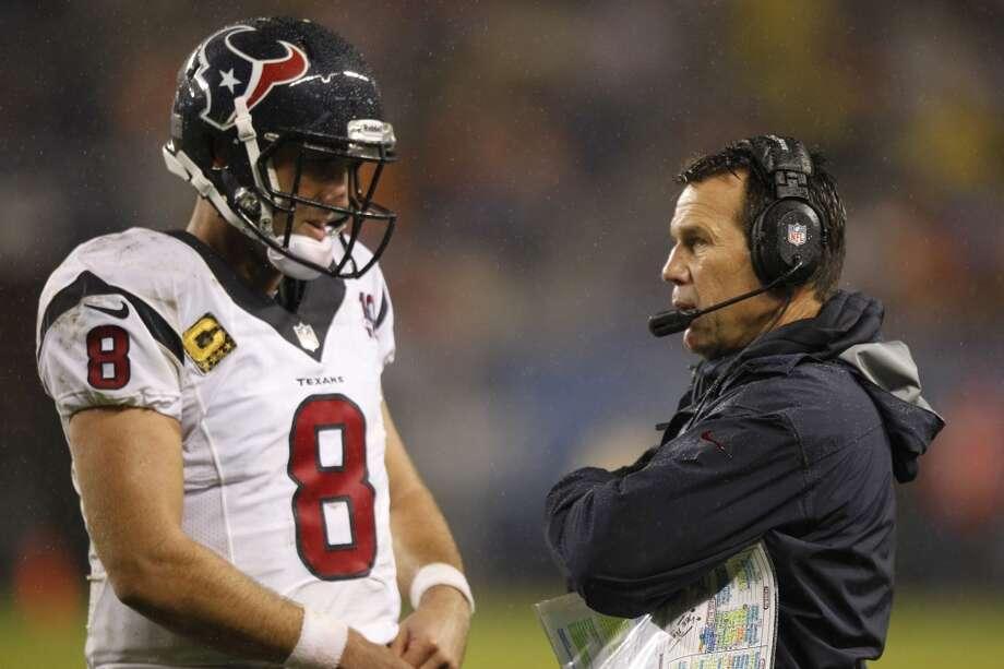 Texans head coach Gary Kubiak confers with quarterback Matt Schaub (8) during the second quarter. (Brett Coomer / Houston Chronicle)