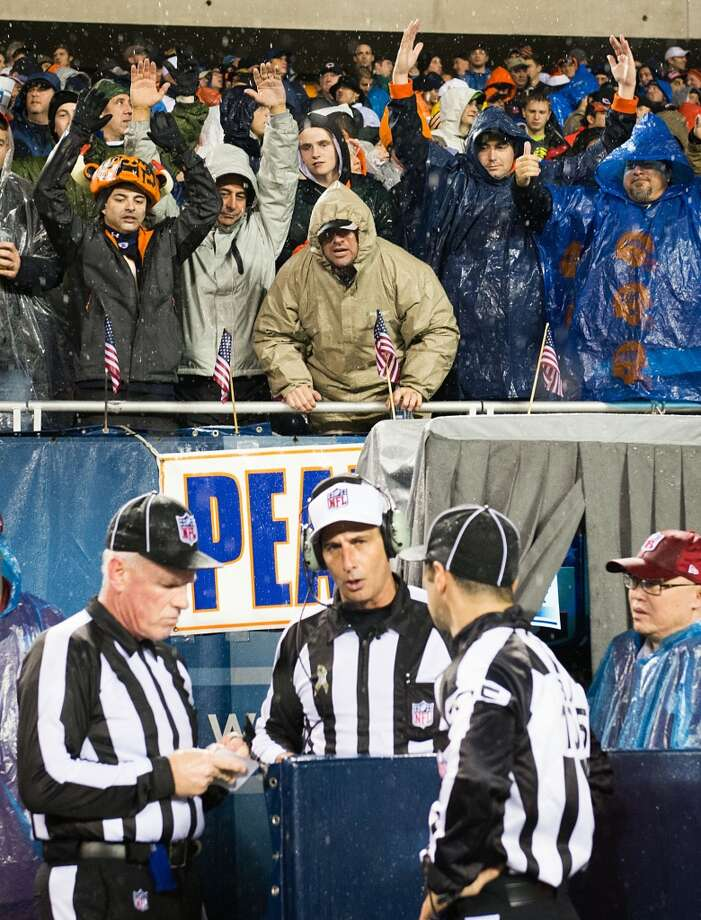 Bears fans yell for a call from referee Gene Steratore as he visits the instant replay booth during the second quarter. (Smiley N. Pool / Houston Chronicle)