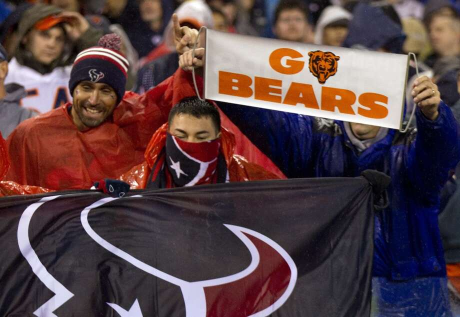 Texans fans vie for attention with Bears fans during the first quarter. (Brett Coomer / Houston Chronicle)