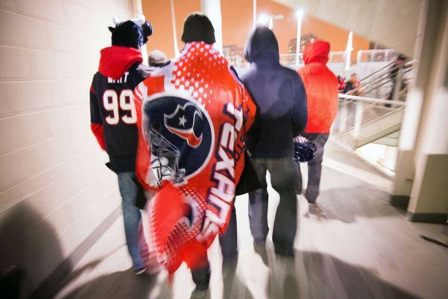 Texans fans head for their seats before an NFL football game against the Chicago Bears at Soldier Field. (Smiley N. Pool / Houston Chronicle)