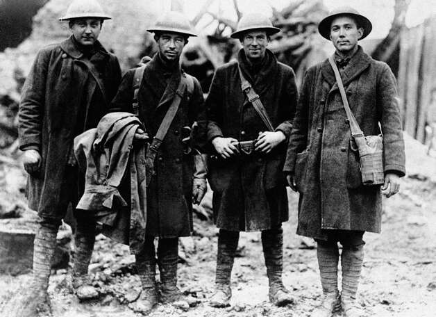 These four American doughboys, runner for the 315th infantry, carried official orders to Lt. Col. Bunt near Etraye, Meuse, France, Nov. 11, 1918, that an armistice had been signed. The group from left Pvts. William Wachter, R.D. Thompson, J.J. Mulcahy and John McGaughtry. Photo: AP