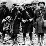 These four American doughboys, runner for the 315th infantry, carried official orders to Lt. Col. Bunt near Etraye, Meuse, France, Nov. 11, 1918, that an armistice had been signed.