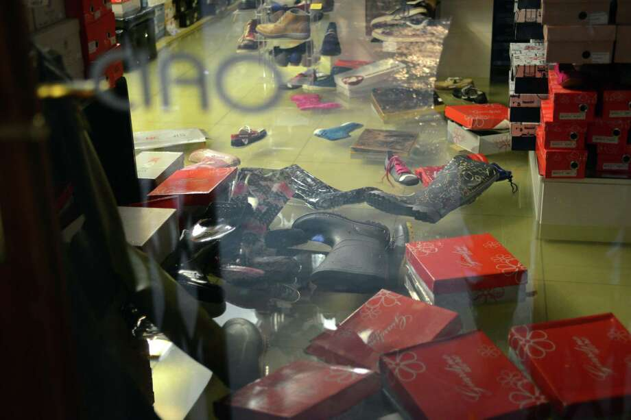 Shoes and wellies float in a flooded shop during a 'acqua alta' on November 11, 2012 in Venice. Rain and wind hit the north of Italy on Sunday and the folooding reached 150 centimetres in Venice.  AFP PHOTO / MARCO SABADINMarco Sabadin,Marco Sabadin/AFP/Getty Images Photo: AFP, AFP/Getty Images / AFP