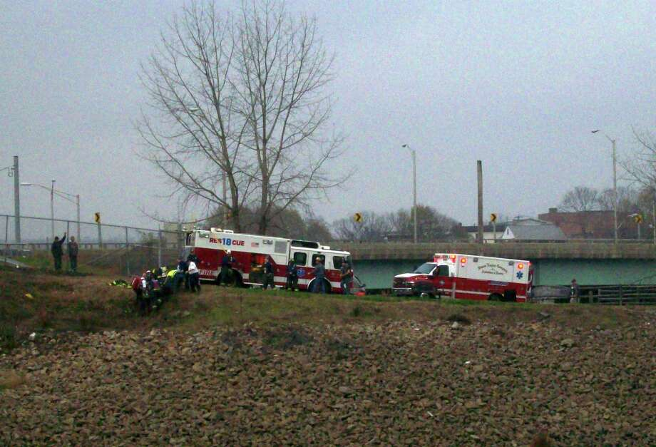 A man who was found lying on the bank of the Naugatuck River in Derby, Conn. on  Monday, Nov. 12, 2012, was rescued by emergency personnel. A litter was used to bring him up the rocky, 100 foot slope. First Assistant Fire Chief Tom Lenart, Jr. said that, although the man, sustained some injuries, they were not life-threatening. Photo: Anne Amato / Connecticut Post