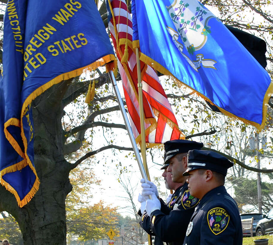 New Canaan Police officers David Payne, Jeffrey Deak and Jason Kim present the colors during the town's Veterans Day ceremony at God's Acre.  Sunday, Nov. 11, 2012, New Canaan, Conn. Photo: Jeanna Petersen Shepard