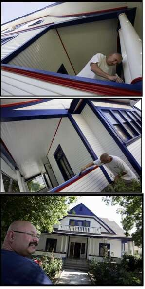 Home in Riverside, CA getting a red, white and blue paint job. (The Press-Enterprise)