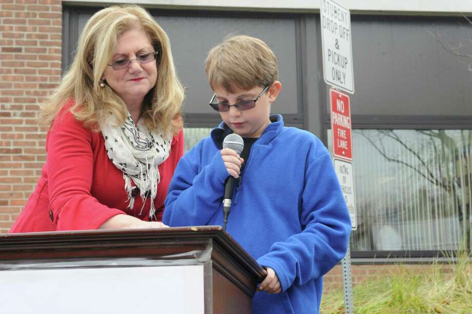 Principal Barbara Riccio listens while Keagan Laczkowski, a 5th grader, speaks during New Lebanon School Salute to Veterans flag-raising ceremony in Byram, Conn., Monday, Nov. 12, 2012. Photo: Helen Neafsey / Greenwich Time