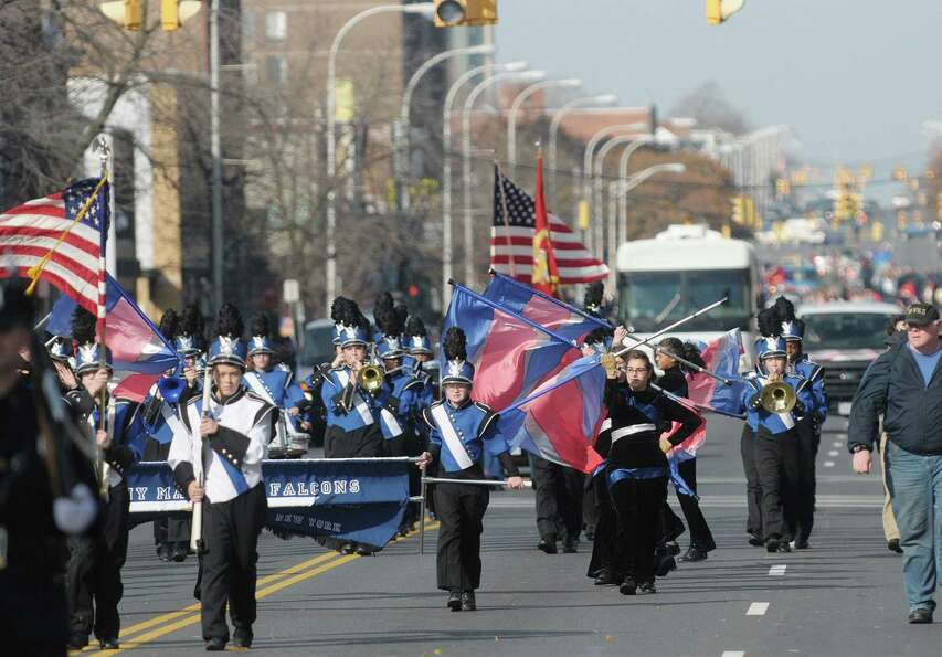Members of the Albany Marching Falcons head down Central Avenue as they take part in the Albany Vete