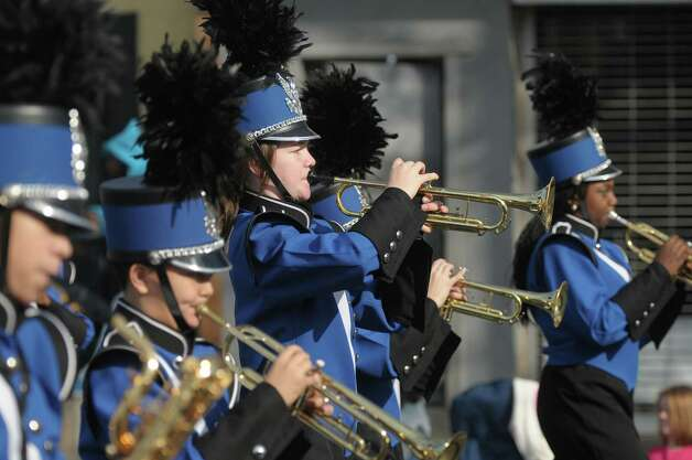 Members of the Albany Marching Falcons play their instruments as they head down Central Avenue  in the Albany Veterans Day Parade on Monday, Nov. 12, 2012 in Albany, NY.   (Paul Buckowski / Times Union) Photo: Paul Buckowski