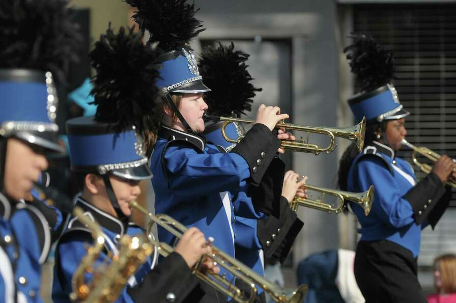 Members of the Albany Marching Falcons play their instruments as they head down Central Avenue  in t