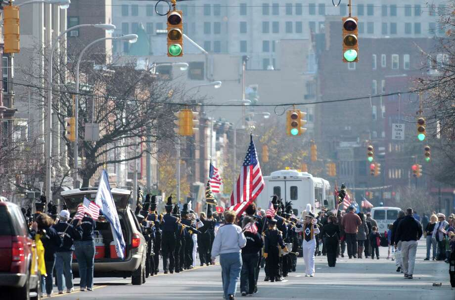 Marching bands and organizations taking part in the Albany Veterans Day Parade head down Central Avenue on Monday, Nov. 12, 2012 in Albany, NY.   (Paul Buckowski / Times Union) Photo: Paul Buckowski