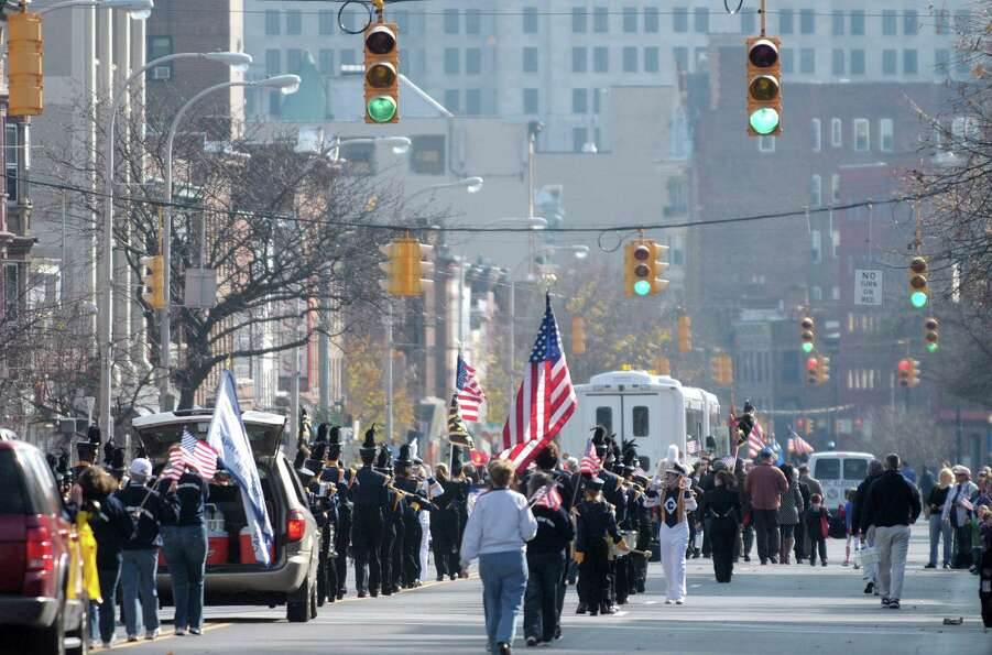 Marching bands and organizations taking part in the Albany Veterans Day Parade head down Central Ave