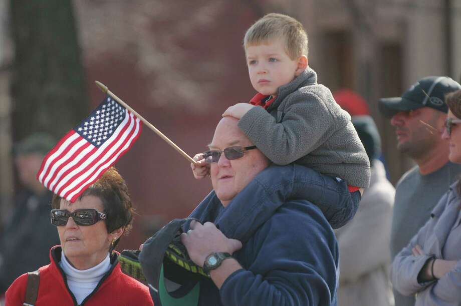 Joan Chambers, her husband Jay Chambers from Albany along with their grandson Vincent Forenzo, 3, from Colonie watch the Albany Veterans Day Parade on Monday, Nov. 12, 2012 in Albany, NY.   (Paul Buckowski / Times Union) Photo: Paul Buckowski