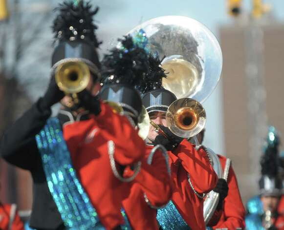 Members of the Mohonasen Marching Band play their instruments as they head down Central Avenue in the Albany Veterans Day Parade on Monday, Nov. 12, 2012 in Albany, NY.   (Paul Buckowski / Times Union) Photo: Paul Buckowski