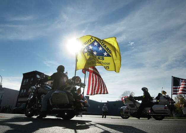 Members of the Patriot Guard Riders head down Central Avenue as they take part in the Albany Veterans Day Parade on Monday, Nov. 12, 2012 in Albany, NY.   (Paul Buckowski / Times Union) Photo: Paul Buckowski