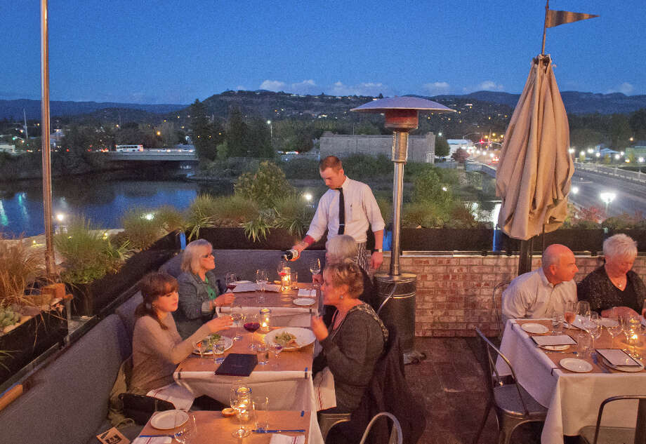 """The third floor includes a second bar and a great patio that looks over the Napa River and the rolling hills and mountains beyond."" Photo: John Storey, Special To The Chronicle / John Storey"
