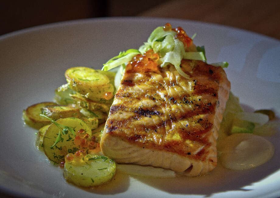 """Wood-grilled salmon ($29) was beautifully cooked, and the precisely cut slaw of fennel and green apple, mixed with pistachio, was an unexpected addition, but chunks of avocado added nothing to the blend."" Photo: John Storey, Special To The Chronicle / John Storey"