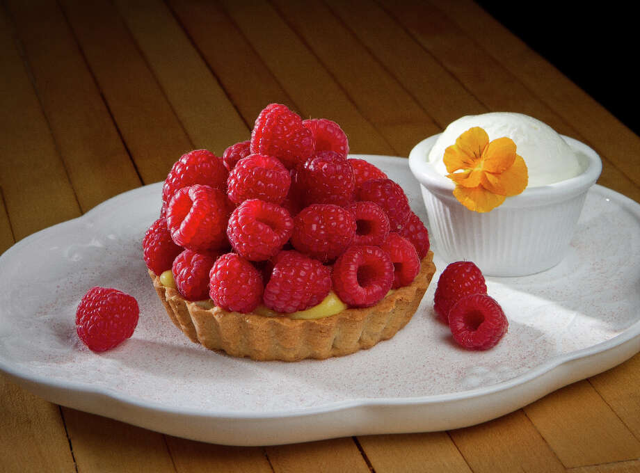 """The best dessert was the fruit tart ($9), which on my visit was fresh raspberries over a passion fruit custard."" Photo: John Storey, Special To The Chronicle / John Storey"