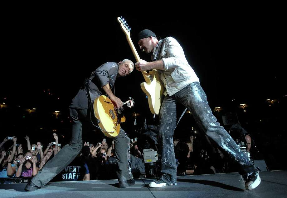Sometimes playing massive stadiums gets boring for U2, so they decided to play on a rooftop.  Photo: Evan Agostini, AP / AGOEV