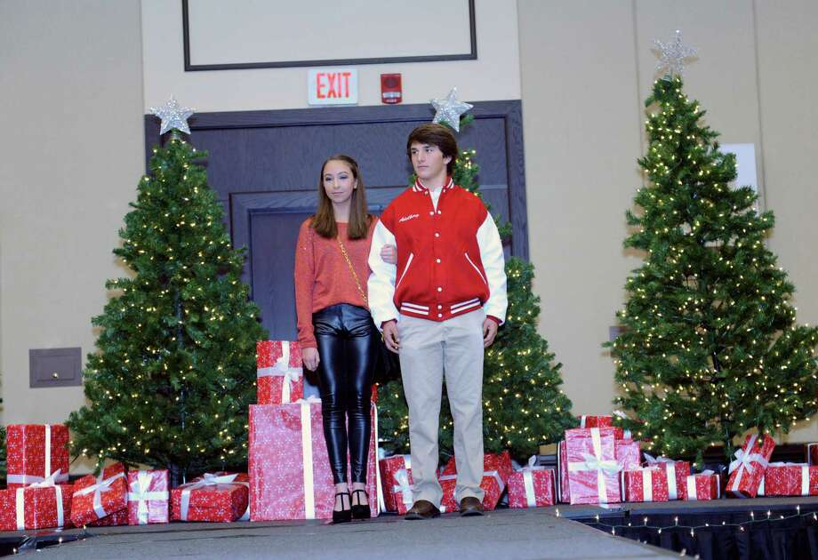 Seniors Jana Bartomoili, and Jesse Adelberg model at the sixth annual Holiday Boutique and Fashion Show to benefit Greenwich High School cheerleading team at the Hyatt Regency Greenwich in Greenwich, Conn., Sunday, Nov. 11, 2012. Senior cheerleading members model while GHS football players escort the cheerleaders down the runway. Photo: Helen Neafsey / Greenwich Time
