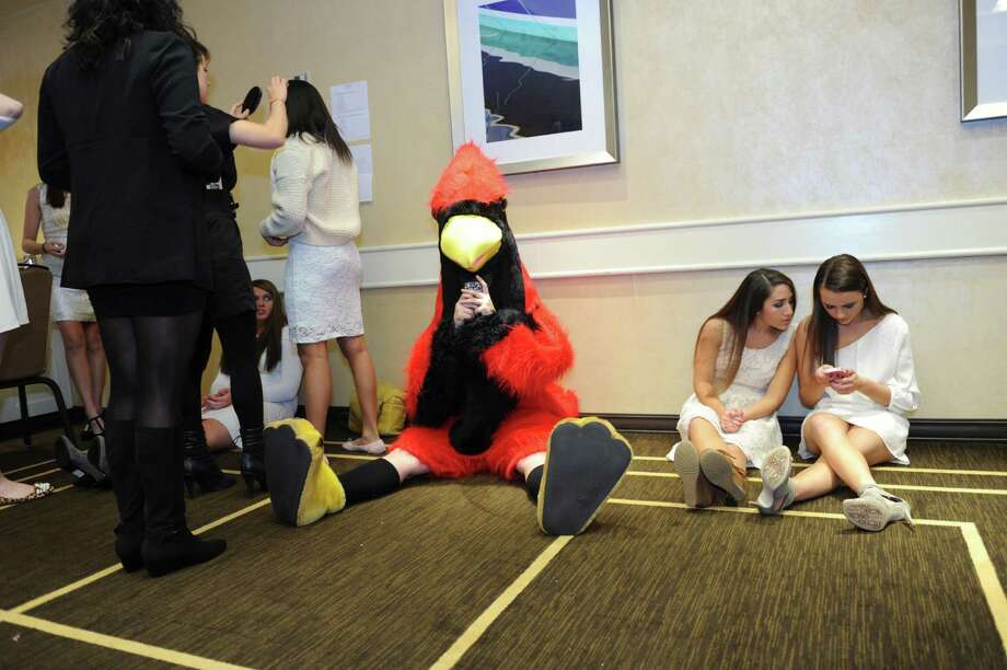 Seniors Kaitlyn Cunningham, left, and Coco Vaccari waiting to model at the sixth annual Holiday Boutique and Fashion Show to benefit Greenwich High School cheerleading team at the Hyatt Regency Greenwich in Greenwich, Conn., Sunday, Nov. 11, 2012. Senior cheerleading members model while GHS football players escort the cheerleaders down the runway. Photo: Helen Neafsey / Greenwich Time