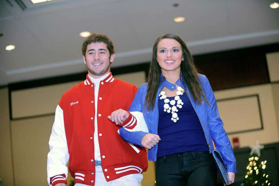 Robert Breck and Hailey Pedicano at the sixth annual Holiday Boutique and Fashion Show to benefit Greenwich High School cheerleading team at the Hyatt Regency Greenwich in Greenwich, Conn., Sunday, Nov. 11, 2012. Senior cheerleading members model while GHS football players escort the cheerleaders down the runway. Photo: Helen Neafsey / Greenwich Time