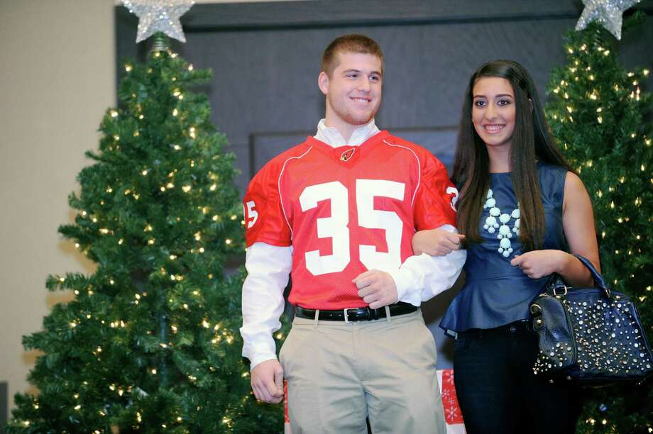 Seniors Mark Bernstein and Gabby DeLorenzo at the sixth annual Holiday Boutique and Fashion Show to benefit Greenwich High School cheerleading team at the Hyatt Regency Greenwich in Greenwich, Conn., Sunday, Nov. 11, 2012. Senior cheerleading members model while GHS football players escort the cheerleaders down the runway. Photo: Helen Neafsey / Greenwich Time