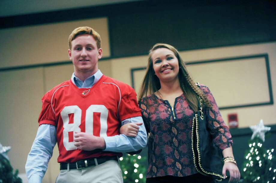 Seniors Joe Kelly and Erin Andrews at the sixth annual Holiday Boutique and Fashion Show to benefit Greenwich High School cheerleading team at the Hyatt Regency Greenwich in Greenwich, Conn., Sunday, Nov. 11, 2012. Senior cheerleading members model while GHS football players escort the cheerleaders down the runway. Photo: Helen Neafsey / Greenwich Time