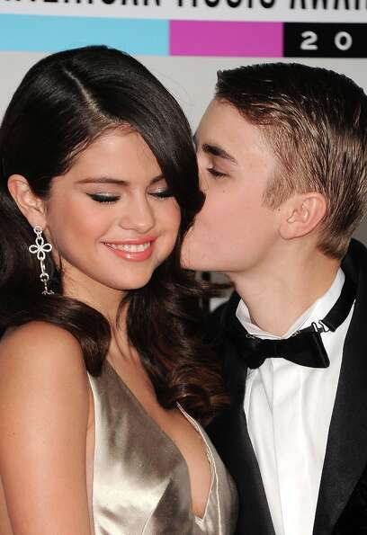 Justin Bieber and Selena Gomez reportedly have split. Here, the singers Selena Gomez (L) and Justin