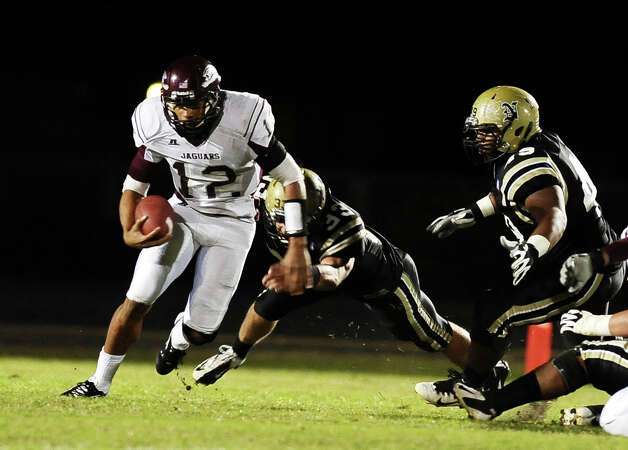 Central quarterback Robert Mitchell, 12, with a quarterback keeper during the Nederland High School football game against Central High School in Nederland on Friday, November 9, 2012.Photo taken:Randy Edwards/The Enterprise Photo: Randy Edwards