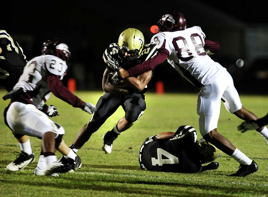 Nederland running back Kendrick Hopkins, 24, charges for another Bulldog first down during the Nederland High School football game against Central High School in Nederland on Friday, November 9, 2012.Photo taken:Randy Edwards/The Enterprise Photo: Randy Edwards